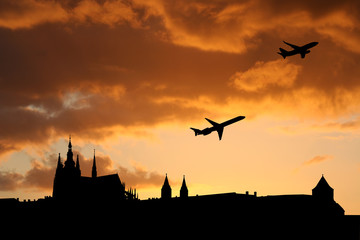 planes departing Prague at sunset