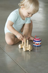 Little boy playing on the floor
