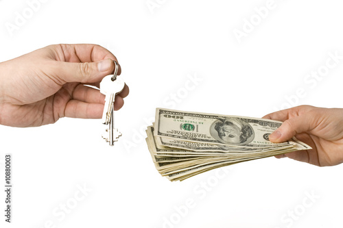Hand with money and key