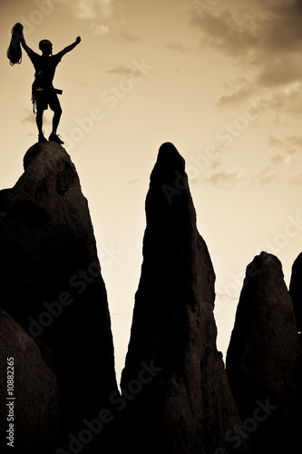 Rock climber on the summit.