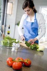 Young woman chopping vegetables