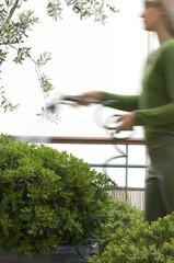 Woman watering bushes