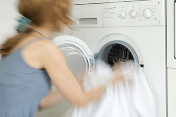 Woman emptying washing machine, close-up