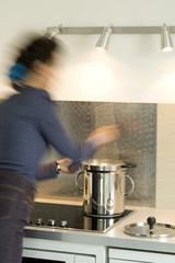 Woman cooking in a steam cooker