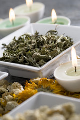 Dried mint and camomile leaves, candles, close-up