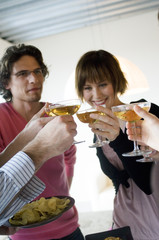 2 couples clinking glasses of champagne