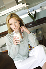 Woman holding glass of milk