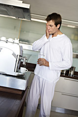Man in kitchen preparing coffee, indoors