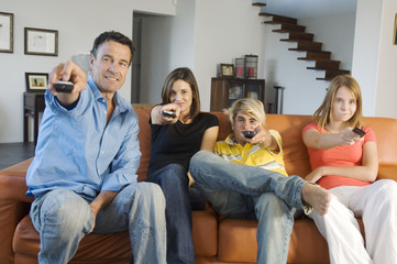 Family watching television, indoors