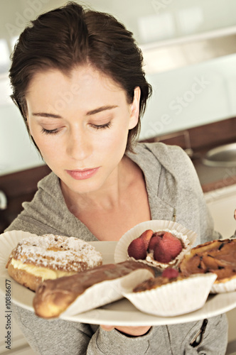 Young woman holding cakes