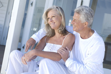 Embracing couple sitting on terrace