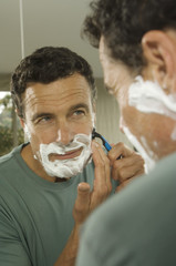 Portrait of a man shaving