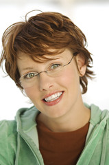 Portrait of young smiling woman with eye glasses