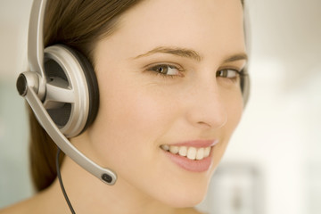 Portrait of a young woman, listening to music with headphones