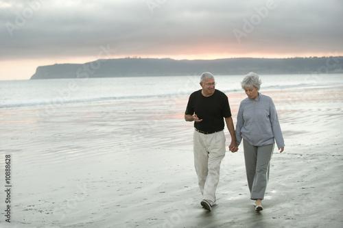 Seniors Walking the Beach - 10888628
