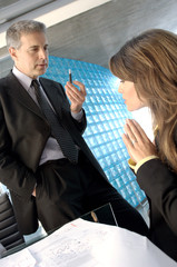 Businessman discussing with executive in office