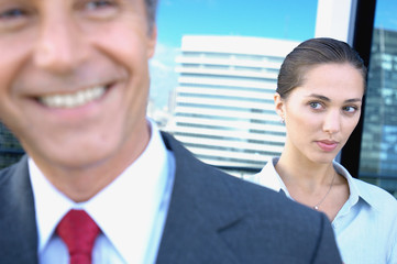 Businesswoman staring at businessman in office