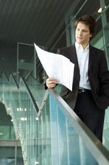 Businessman looking at a blueprint