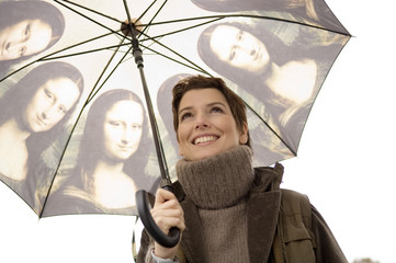 Close-up of a mid adult woman holding an umbrella