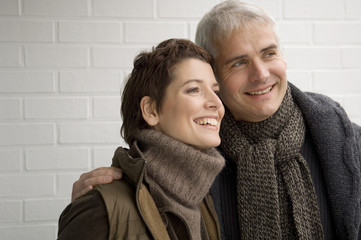 Close-up of a mature man and a mid adult woman smiling