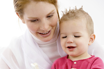 Young woman and her son looking at toothbrush