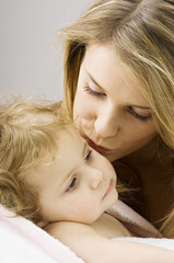 Close-up of a young woman kissing her son