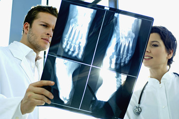 Close-up of two doctors examining an X-Ray report