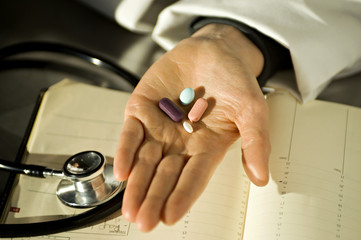 Close-up of pills on a doctor's palm