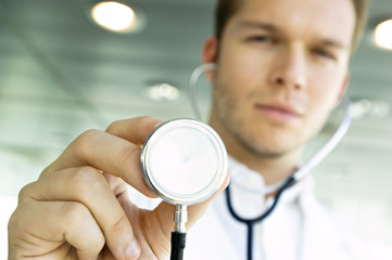Close-up of a male doctor holding a stethoscope
