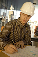 Male architect working on a blueprint