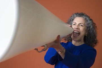 Woman yells into a megaphone