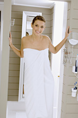 Portrait of a young woman wrapped in a bath towel