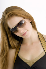 Close-up of a young woman wearing sunglasses