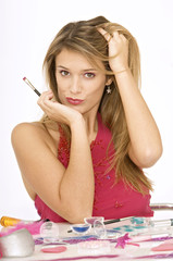 Portrait of a young woman holding a make-up brush