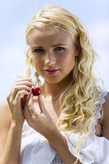 Portrait of young woman with cherries