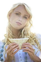 Young woman holding a sandwich