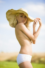 Young woman wearing panties and hat