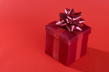 A red gift box on a red background