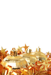 Gold Christmas baubles in tinsel