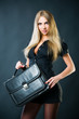 Sexy businesswoman with suitcase