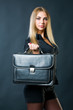 Attractive businesswoman with suitcase