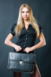 Beautiful businesswoman with suitcase
