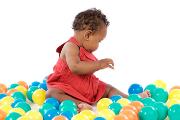 Baby with balls