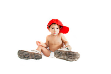 toddler boy in parent's boots over white