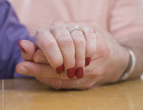 Mature couple holding hands.
