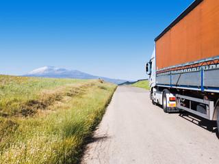 landscape for truck on road, background volcano Etna