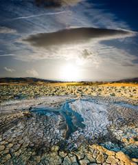 surreal landscape volcano erupted liquid mud to sunset