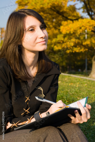The girl writes a diary on fresh air