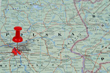 Pin pointing Warsaw on polish map in atlas poster
