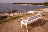 A bench and a slipway at the Adriatic coast poster